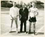 Attallah A. Kidess standing with two tennis players