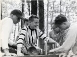 Boys participating in experiment at Camp Massasoit