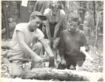 Campers using an axe at Freshman Camp (1953)