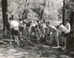 Campers raking at Freshman Camp (1953)