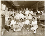 The Harlem Globetrotters and the New York Celtics at the La Perla Cigar and Cigarette Factory in ...