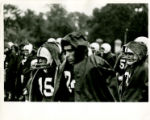Springfield College Football players on sideline in rain, 1965