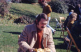 Dick Whiting carrying a plate of food