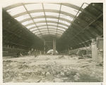The interior of the Memorial Field House during dismantlement at the Sampson Naval Training...