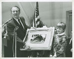 Kathleen Camuse Presents Art Linkletter with a Photograph of Linkletter Natatorium, 1967