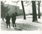 Two students walking to class at Schoo-Bemis in Winter