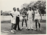 1965 Far East Tour, basketball players standing on dirt court