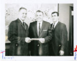 Wilbert E. Locklin standing with Dick Whiting and Doug Coupe