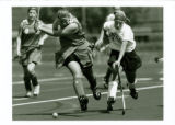 Sarah Kelly playing field hockey against opponent