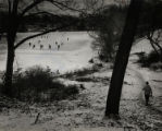 Students playing ice hockey on Lake Massasoit
