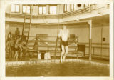 Student jumping into McCurdy Natatorium