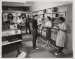 Students reading in bookstore (1959)